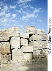 Travertine stone blocks.