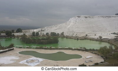 travertines with blue water in pamukkale, turkey.