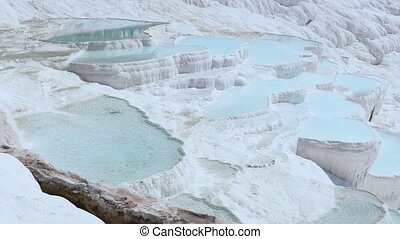 Travertines with turquoise water in Pamukkale.