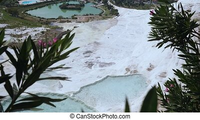 Travertines with turquoise water in Pamukkale. - Travertines...