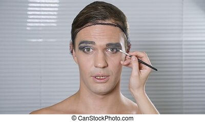 Travesty make up. a young man makes himself a transsexual...