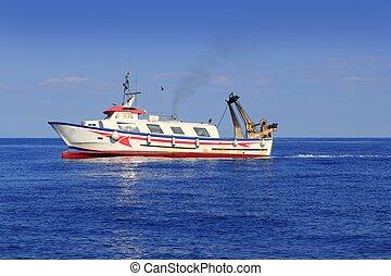 trawler fisherboat boat working in mediterranean offshore blue water