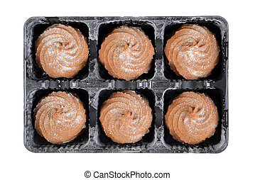 tray of gingerbread swirl cookies with icing sugar
