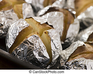 Tray of Jacket Potatoes Wrapped in Foil