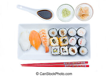 Tray of sushi on a white background seen from above