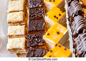Tray with assorted cakes on the table