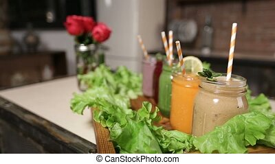 Tray with assortment of smoothies in jars