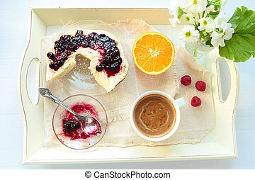 Tray with breakfast. Roll with currant jam and cup of coffee