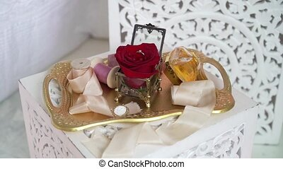 Tray with jewelry ring and red rose