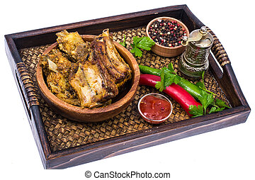 Tray, wooden bowl with spicy ribs, ketchup