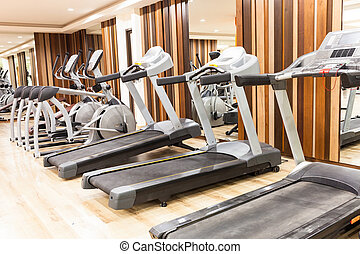 Treadmill in Modern gym interior with equipment
