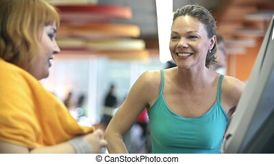 Treadmill Jogging - Front view of personal trainer watching...