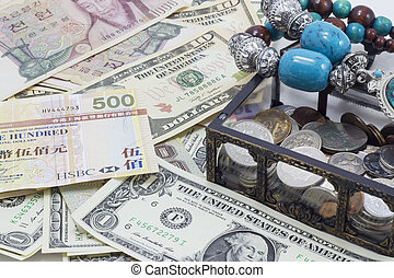 Banknotes, coins, necklace and coffer