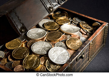 Treasure Chest filled with gold Krugerrand coins from South Africa, silver Walking Liberty coins from the United States of America and assorted change.