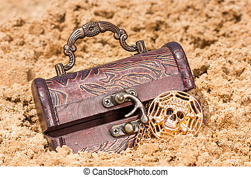 Treasure chest with  the gold  on a sandy beach