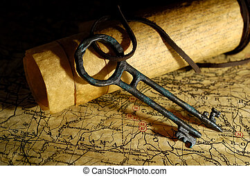 Treasure Key - Photo of Vintage Maps and a Tresure Chest Key...