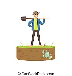 Treasure seeker standing with shovel in his hand