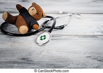 treat children - stethoscope and teddy bear