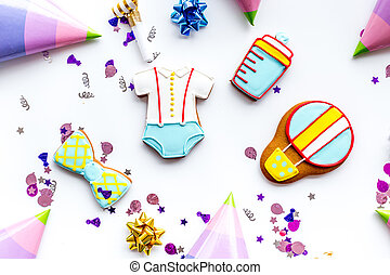 treat for baby birthday party with gingerbread cookies on white background top view pattern