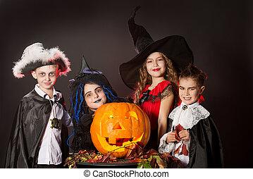 treat or trick - Cheerful children in halloween costumes ...