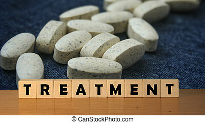 TREATMENT concept message word on a wooden desk on cube blocks