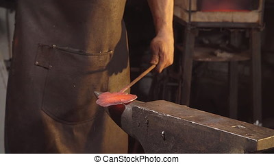 Treatment of molten metal close-up. Handmade blacksmith.