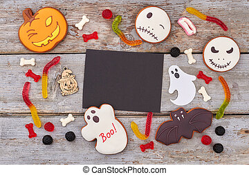 Treats for Halloween party on wooden background.