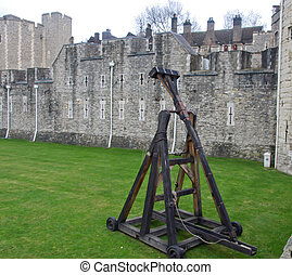 middle age weapon trebuchet in the yard of Tower of London