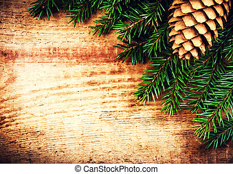 Tree Branch on wooden background with forest cone and copy space