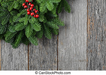 Tree branch with Holly Berry on rustic wooden background used fo