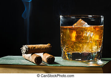 Tree cigar and whiskey with ice in glass