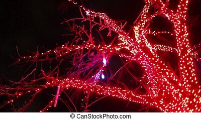 Tree decorated by garland, lamps blinking
