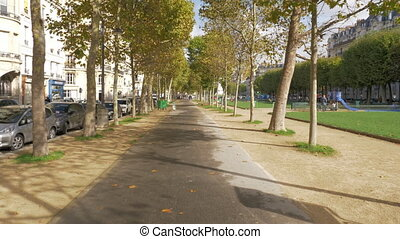 Tree lined walkway in autumn Paris, France - PARIS, FRANCE -...