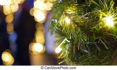 Tree night city decoration - Rack focus of a large outdoor...