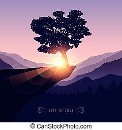 tree of love on a cliff in the mountains at sunset