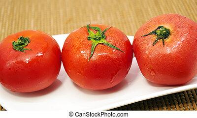 tree red fresh tomato on white plate