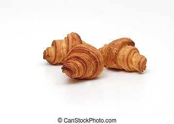 Tree small croissants, isolated on white background