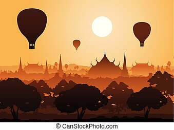 tree temple image of Buddha sculpture pagoda sea and balloon above,Myanmar,Thailand