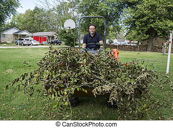 Tree Trimmer With Load Of Limbs