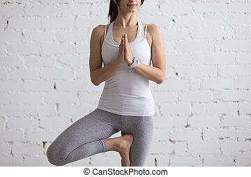 beautiful woman meditating in savasana pose close up