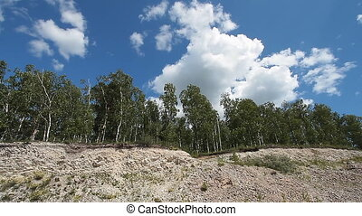 Trees in quarry 2 - Sky clouds and landscape trees in...