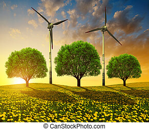 Trees with wind turbines on meadow