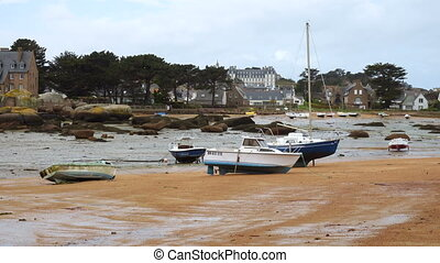 Yachts and boats during ocean low tide