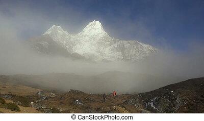 Trekker below Ama Dablam in the Nepal Himalaya.
