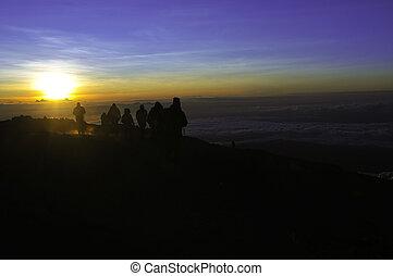 Trekkers on Kilimanjaro at Sunrise