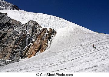 Trekking in the Himalayas - Trekkers crossing the pristine...