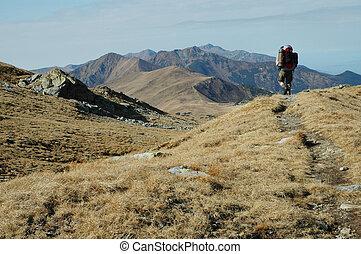 Trekking man in the mountains