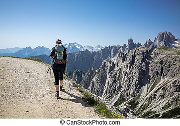 Trekking - One young woman practising trekking in Lavaredo,...