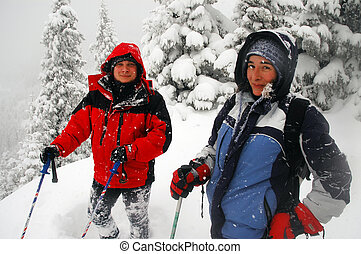 Trekking people in the winter mountains