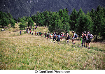 trekking people on italian alps